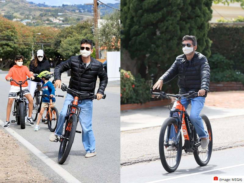 Simon Cowel and Family riding e-bikes